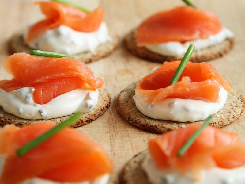 Tasty salmon apetizers with sour cream